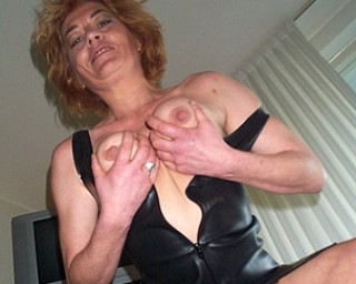 Shaved mature slut knows what to do with toys